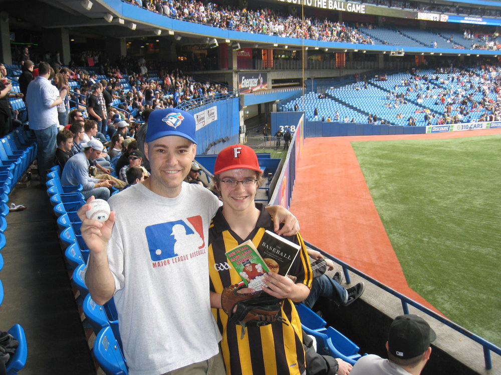 with a fan and my 5,000th ball at Rogers Centre