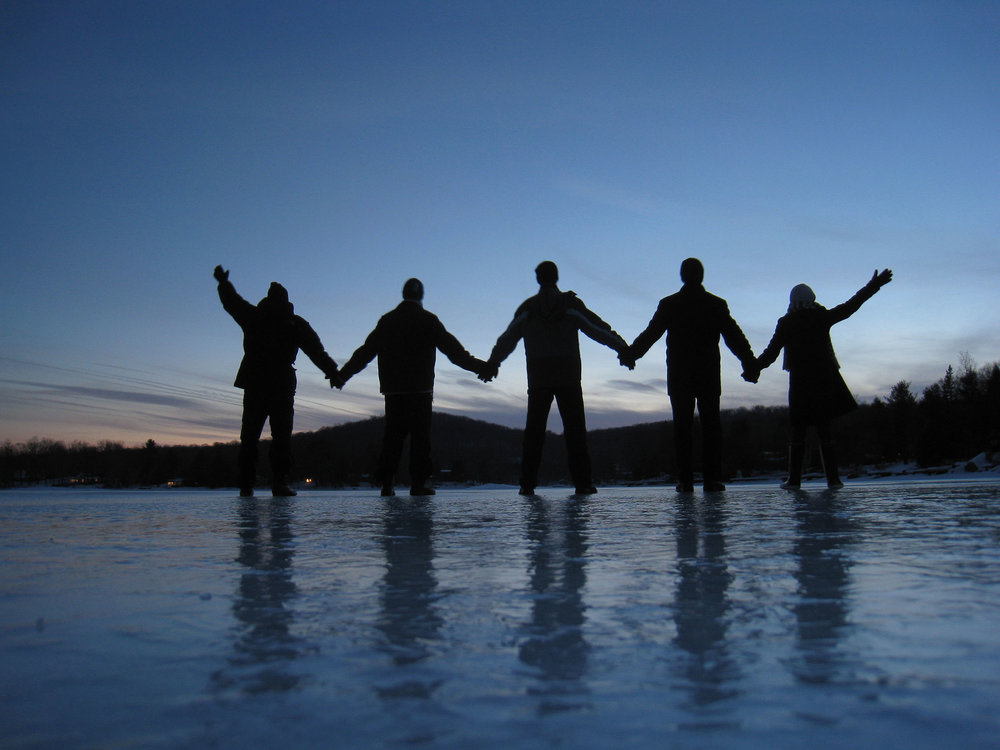 with friends on a frozen lake; I'm on the left