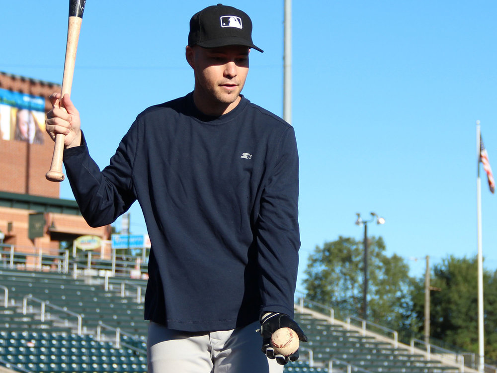 hitting fungos at LeLacheur Park in Lowell, MA