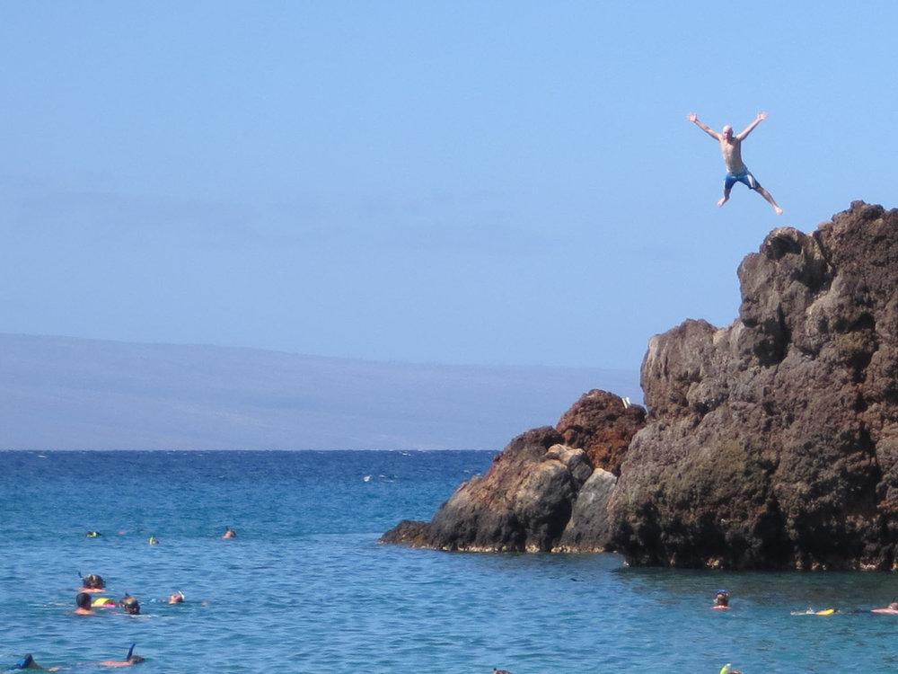 jumping off a big-ass rock in Hawaii