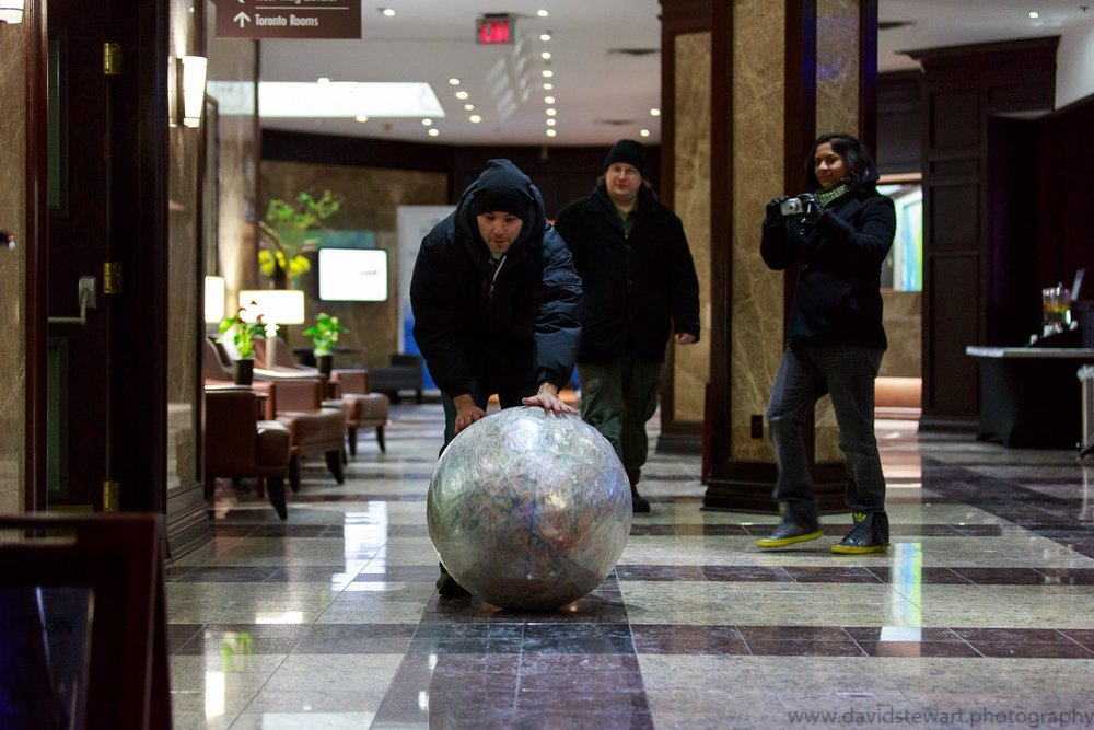 rolling my rubber band ball though a hotel lobby in Canada