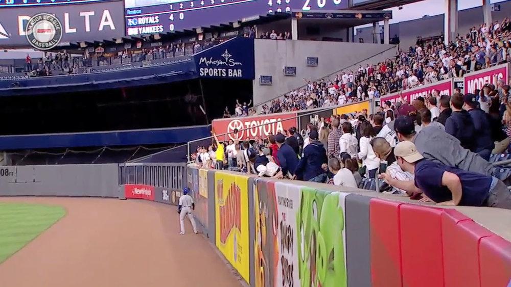 wearing yellow; catching a Carlos Beltran homer