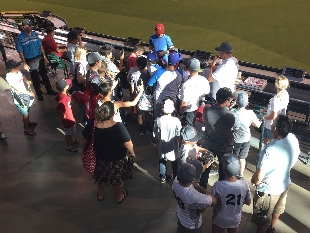 signing autographs for kids at Chase Field