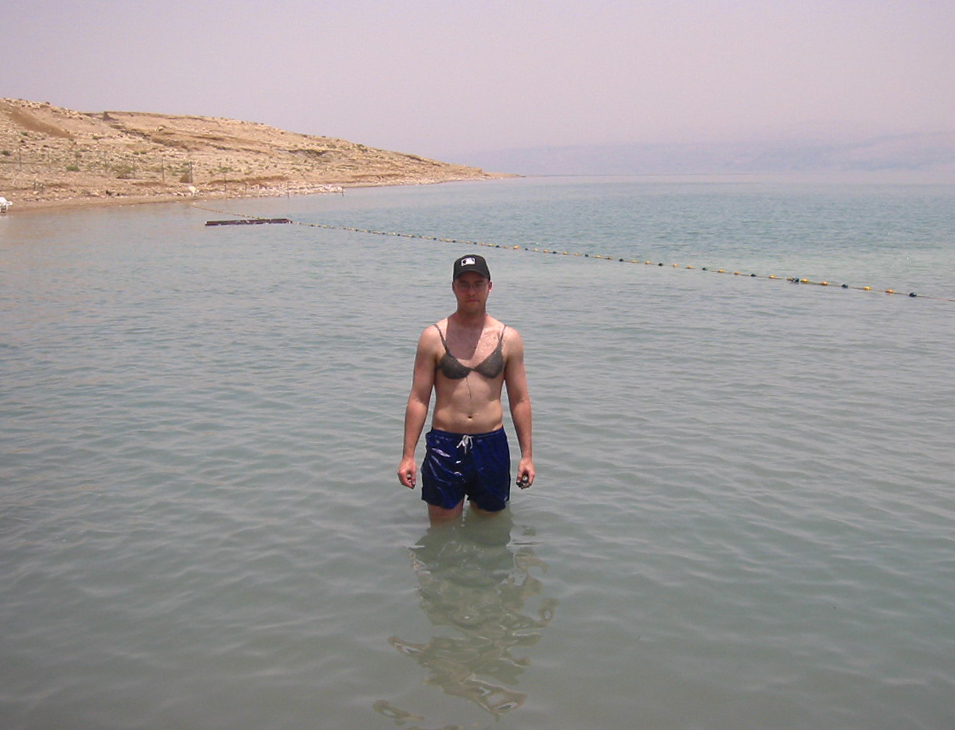 in the Dead Sea with mud painted on me in the shape of a bikini