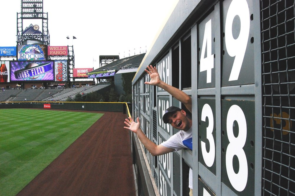 inside the manual scoreboard at Coors Field