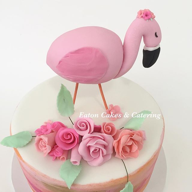 Handmade flamingo and floral arrangement sat beautifully on top of Jessica's watercolour cake for her 10th birthday celebration  #eatoncakes #cupcakes #cookies #fondantflowers #handmade #prettyinpink #flamingoparty #watercolourpainting #flamingo #cake #macarthurnsw #lovelocal