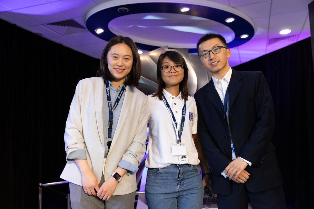 Zero Build Stop members Bao Yu (left) and Yan An (right) with Rolls-Royce Singapore mentor Gennie (middle)