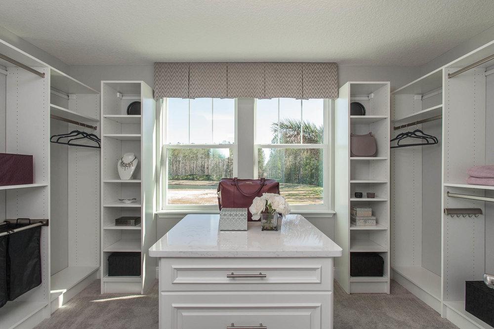 dayton-dr-horton-dr horton-st johns-jacksonville-florida-nefba-northeast florida-southeastern united states-residential interior design-transitional-master-closet-closet island.jpg