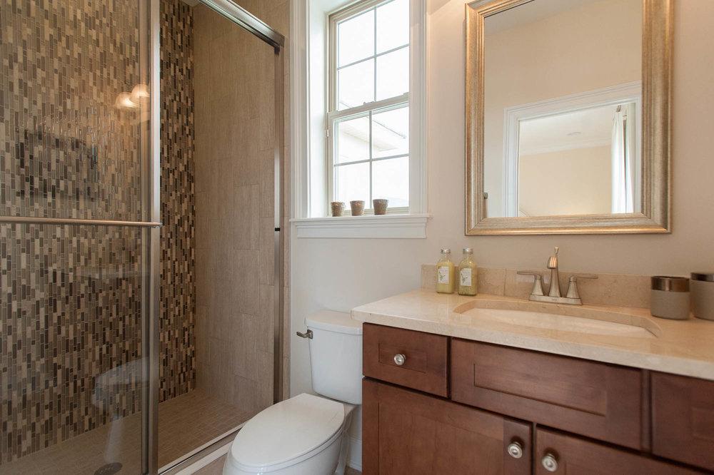 sterling-lennar-celestina-st johns-florida-nefba-northeast florida-southeastern united states-residential interior design-contemporary-bathroom-shower-tile-restroom.jpg