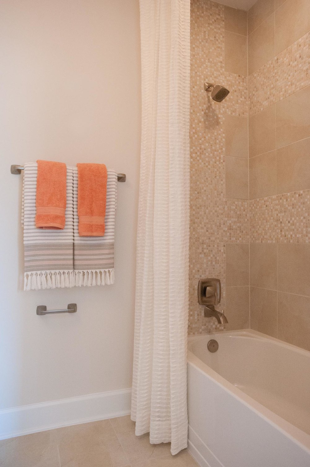 sterling-lennar-celestina-st johns-florida-nefba-northeast florida-southeastern united states-residential interior design-contemporary-bathroom-white cabinet-bathtub-shower-tile.jpg