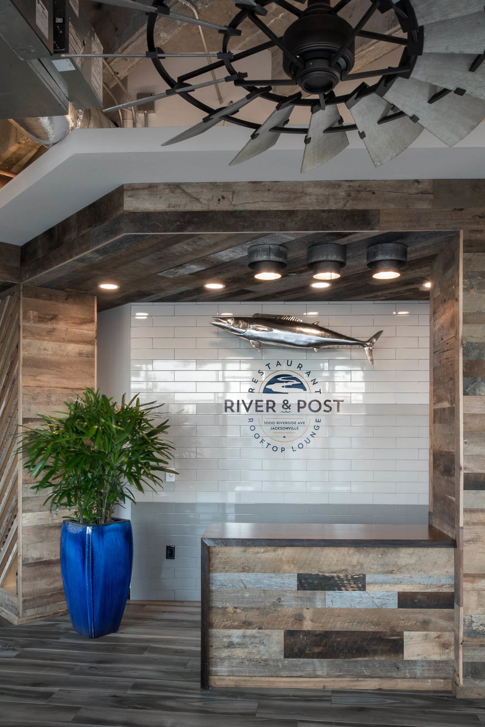 River and Post Restaurant Rooftop Lounge Jacksonville Florida Hostess Stand Entrance Commercial Interior Design reclaimed wood subway tile.jpg