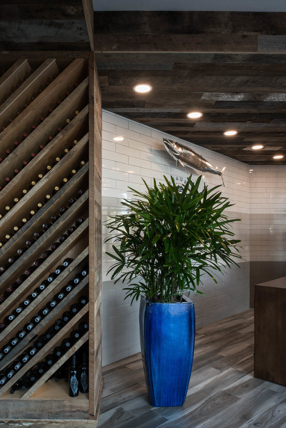 River and Post Restaurant Rooftop Lounge Jacksonville Florida Hostess Stand Entrance Commercial Interior Design reclaimed wood subway tile wine rack.jpg