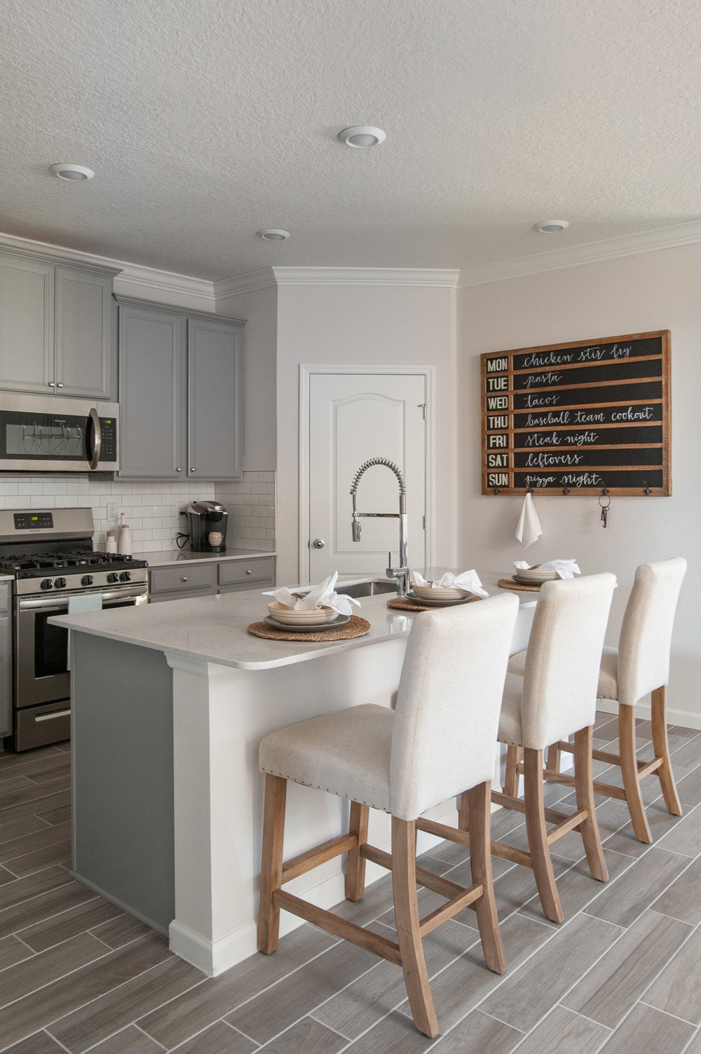 Micamy_Interior Designer_Design_Interior_Model_Merchandising_Kitchen_Grey_Cabinets_Forty West_Lennar_Place Setting_SubwayTile_Farmhouse_Faucet.jpg