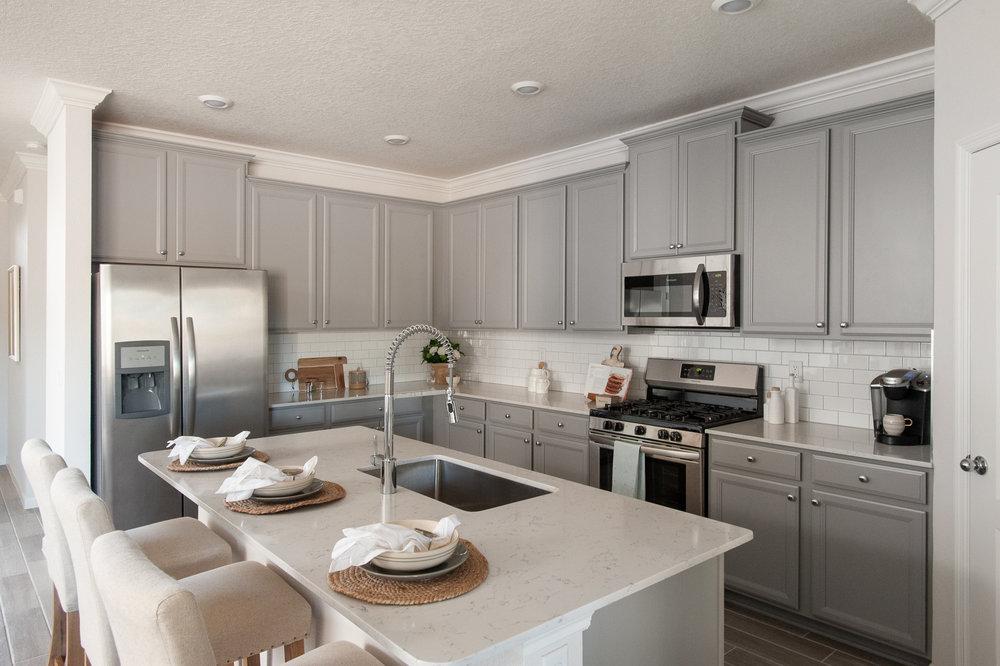 Micamy_Interior Designer_Design_Interior_Model_Merchandising_Kitchen_Grey_Cabinets_Forty West_Lennar_Place Setting_SubwayTile_Farmhouse.jpg