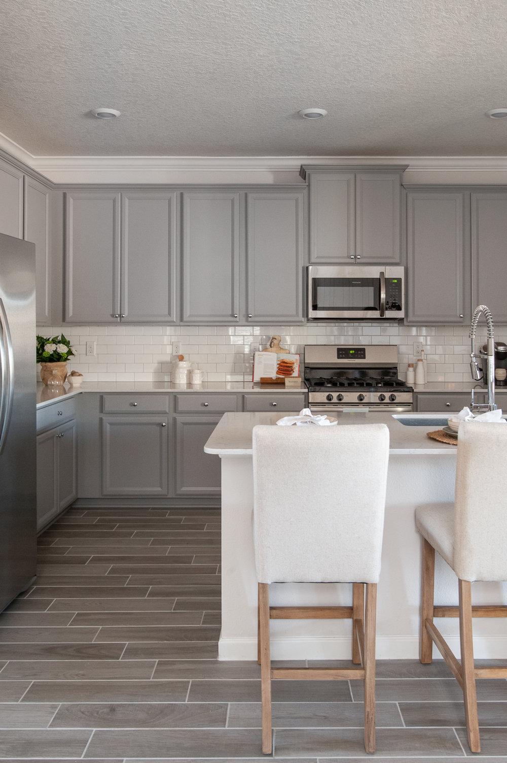 Micamy_Interior Designer_Design_Interior_Model_Merchandising_Kitchen_Grey_Cabinets_Forty West_Lennar_Place Setting_SubwayTile_Farmhouse_TileFloor.jpg