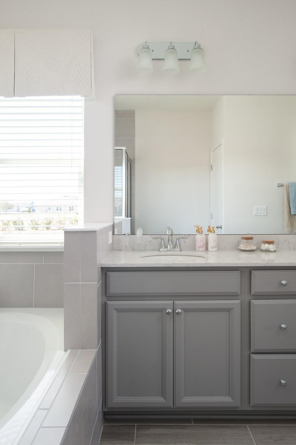 Micamy_Interior Designer_Design_Interior_Model_Merchandising_Owners_Suite_Universal_Furniture_Traditional_Transitional_Bathroom_Vanity_Grey_Cabinets_Bath.jpg