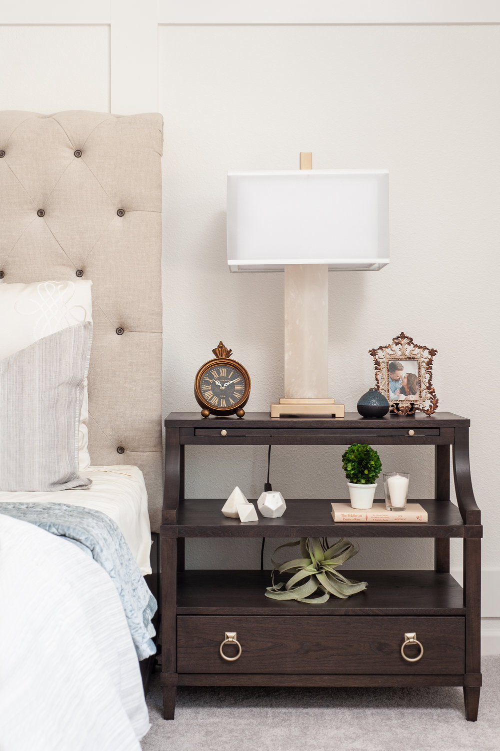 Micamy_Interior Designer_Design_Interior_Model_Merchandising_Owners_Suite_Universal_Furniture_Traditional_Transitional_Nightstand_Styling_Uttermost_Accessories.jpg