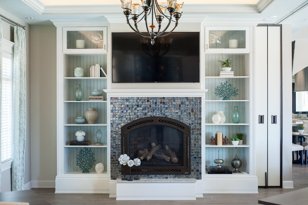 Micamy_Design_Studio_Interior_Design_Artisan_Lakes_Clubhouse_Serene_Coastal_Glass_Mosaic_Tile_Backsplash_Fireplace_SherwinWilliams_Crossville_Blue_ (3).jpg