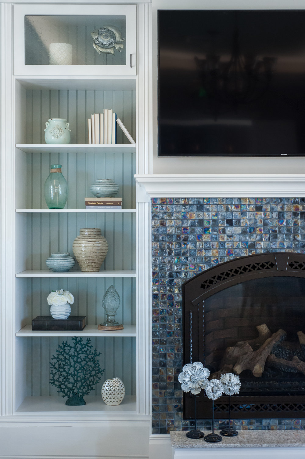 Micamy_Design_Studio_Interior_Design_Artisan_Lakes_Clubhouse_Serene_Coastal_Glass_Mosaic_Tile_Backsplash_Fireplace_SherwinWilliams_Crossville_Blue_ (4).jpg