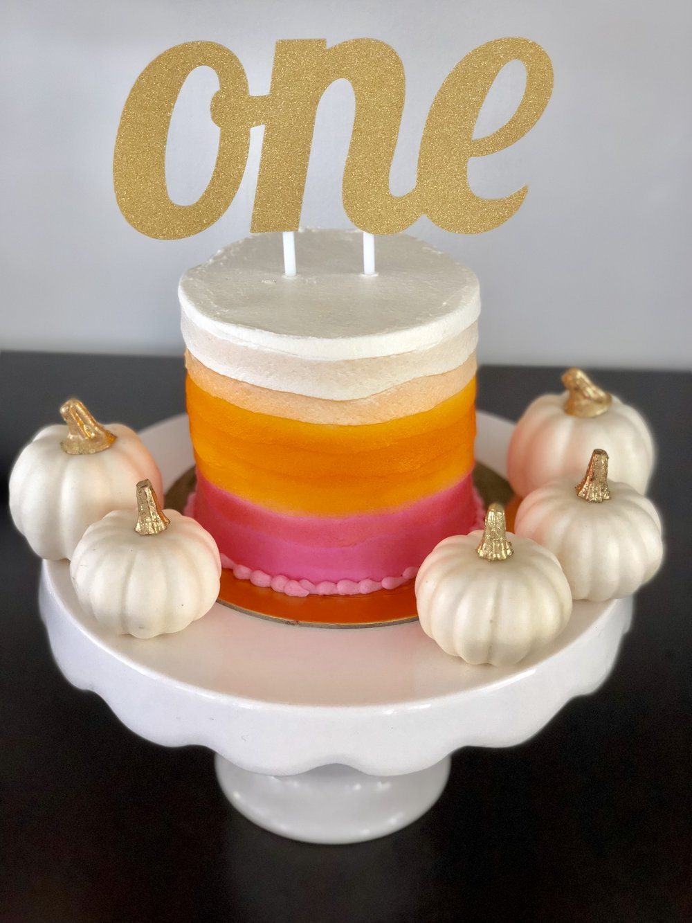 ombre pink and orange smash cake.jpg