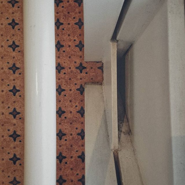 Repeating pattern under railing. #digitalphotograph  #carpet