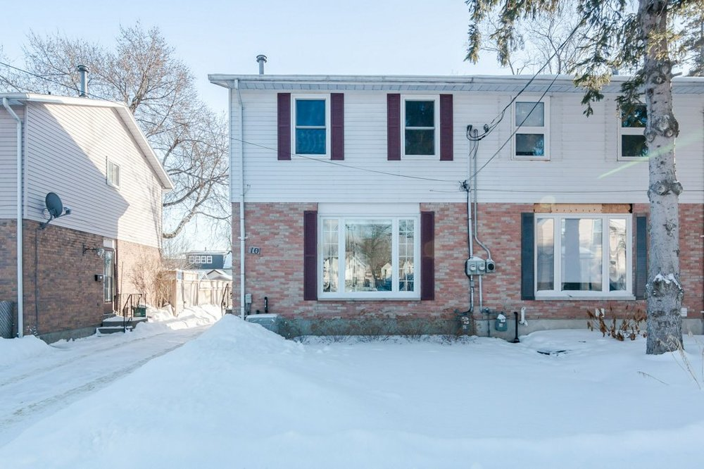 10 Corrigan St. - A fully renovated three-bedroom semi-detached home with a finished basement, parking, and a modern kitchen. A ten-minute stroll to downtown.Listed at $325,000.