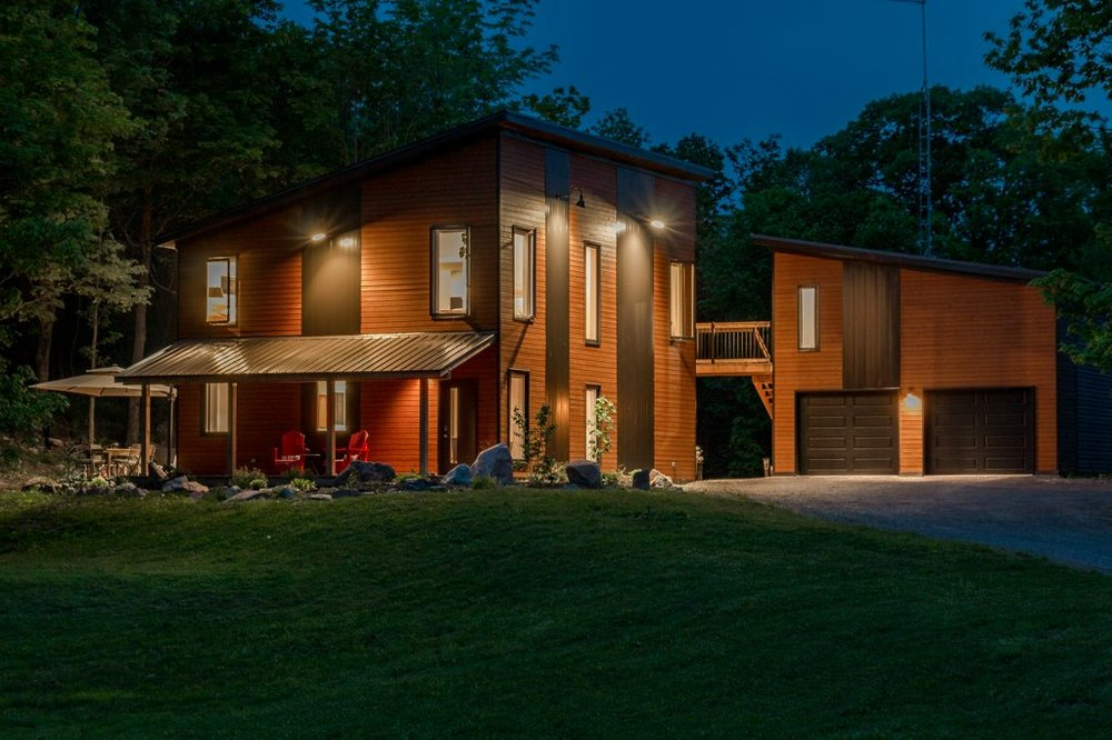 5911 Battersea Rd. - A modern 2 storey home set on 3 acres of Canadian shield and rock, with double garage, a studio and geothermal heating.Listed at $525,000.