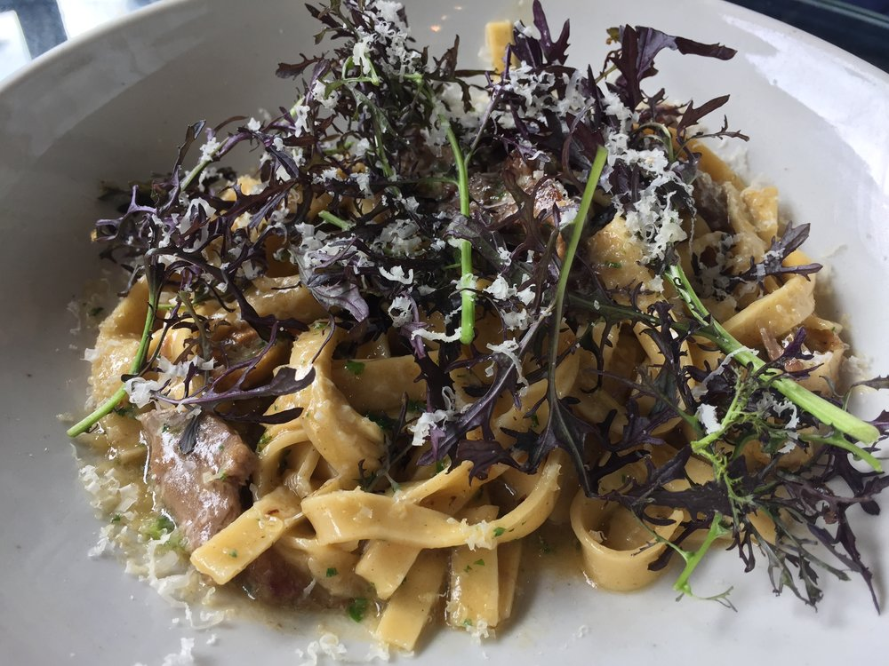 Braised lamb, tagliatelle pasta, chilli, olives, parmesan butter