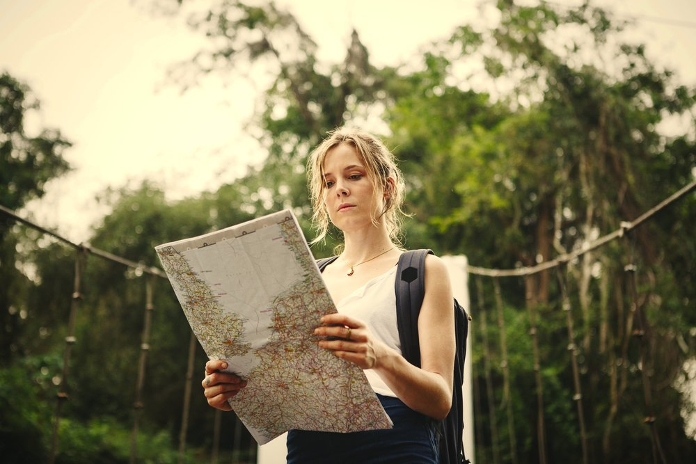 woman-following-a-map-in-nature-US3JCAK.jpg