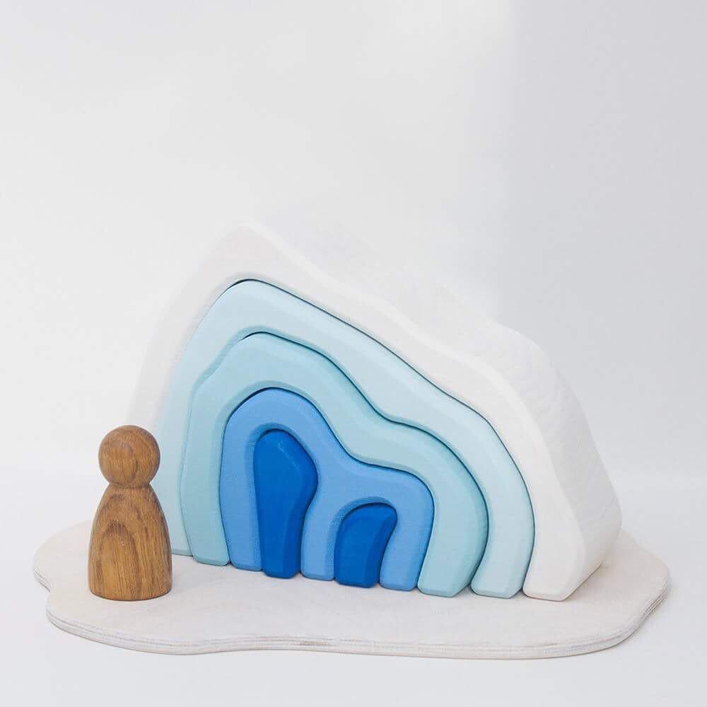 The Glacier   Explore an Arctic ice cave or create an icy world for your animals and dolls. How many ways can you play?  Lime wood Play Scene cut from a single block of FSC kiln dried lime wood. Stained with water based, non-toxic colour and with a slightly textured surface.  Approximately 190mm x 140mm x 54mm RRP £33