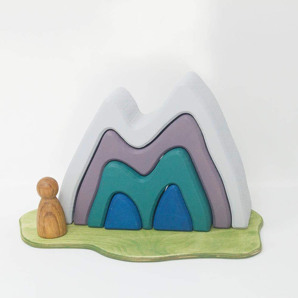 The Mountain   Every little explorer needs a mountain to climb or a cave to explore. How many ways can you play?  Lime wood play scene cut from a single block of FSC kiln dried lime wood. Stained with water based, non toxic colour, and left slightly textured.  Approximately 200mm x 150mm x 53mm RRP £33