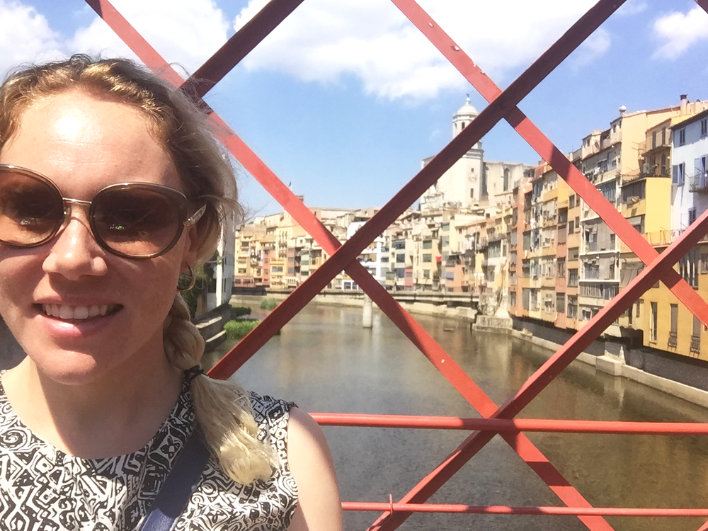 Standing on the Eiffel Bridge in Girona, Spain, on my way to a dinner by myself!