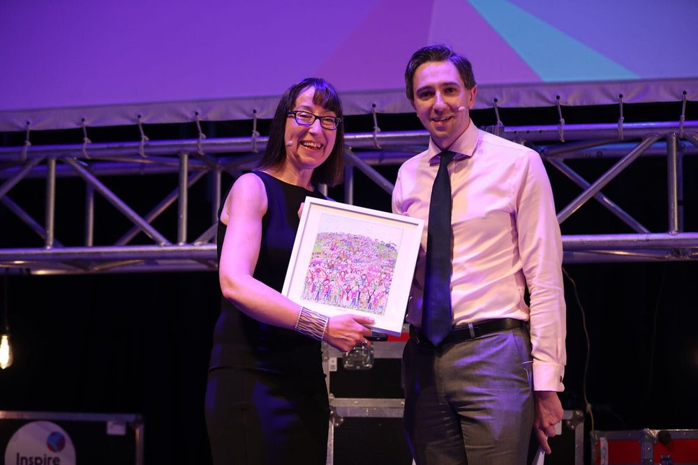 Ann O'Dea CEO Inspirefest presenting Minister Harris with a #Togetherforyes print