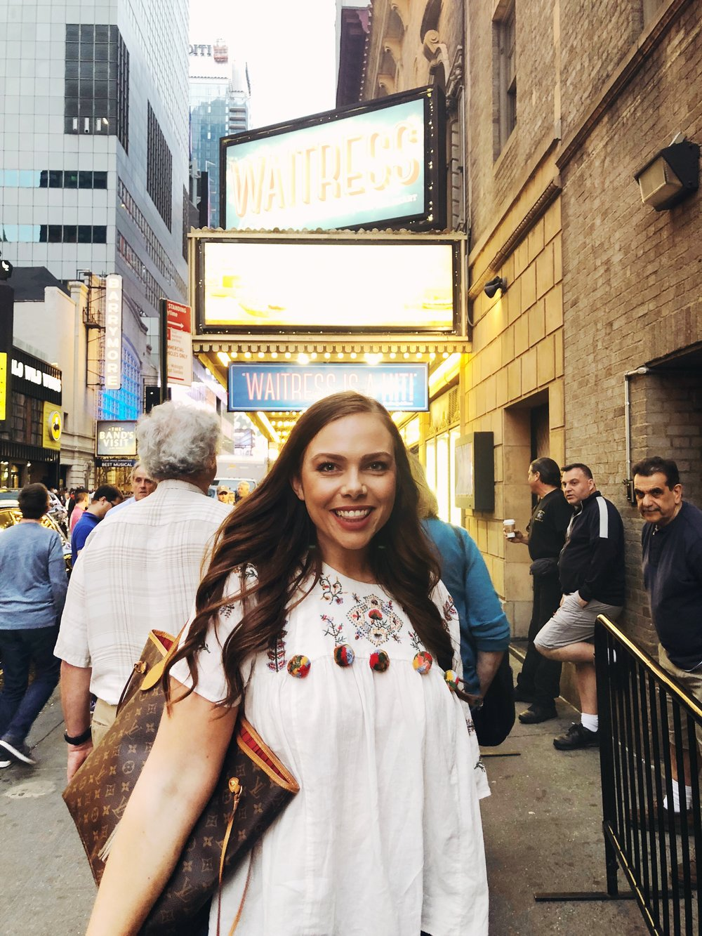 I took a picture in front of each sign of all four musicals we saw in NYC during that long weekend! Waitress was my fave!