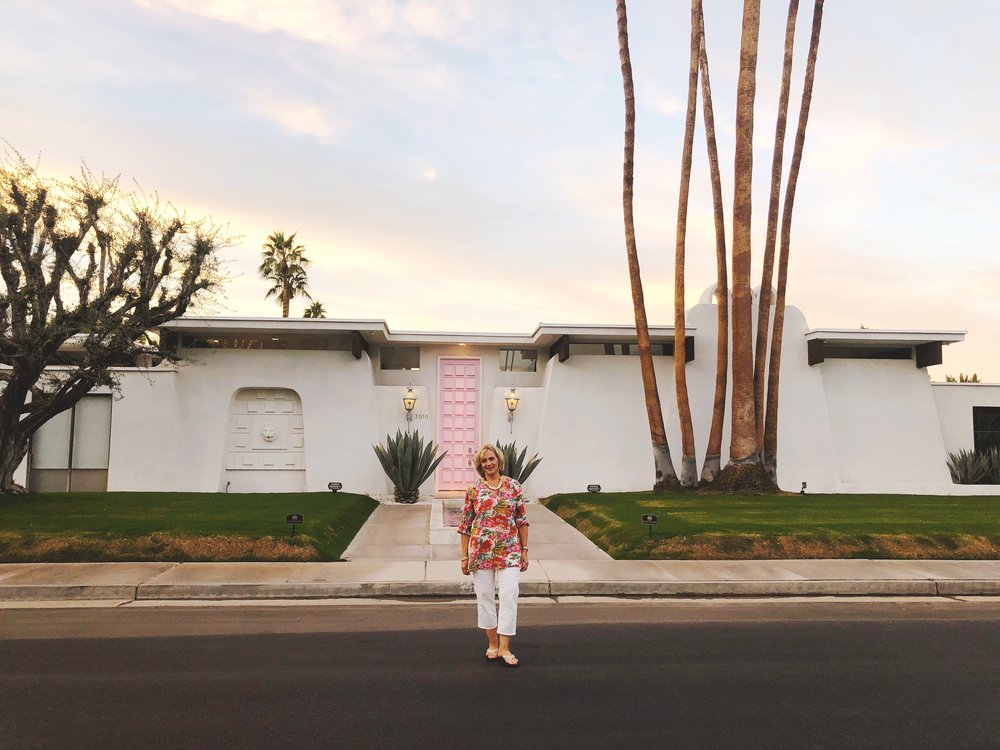 """My cute momma in front of """"That Pink Door."""" Isn't she so cute? We took a drive around the neighborhood and oooh-ed and ahhh-ed at all of the gorgeous architecture and pops of color! I decided I'd probably go for a green door, and she thinks she'd go with an orange one."""
