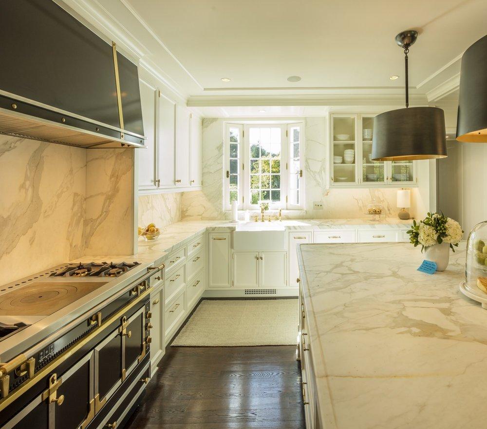 Kitchen, full stonework splash and window surround, and millwork—designed for Hamady Architects