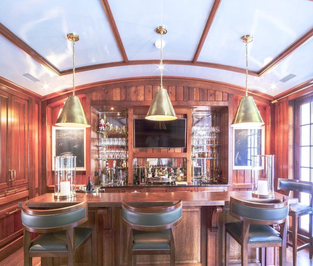 The gameroom bar using antique hardwoods from Virginia; built by Gaston & Wyatt—designed for Hamady Architects