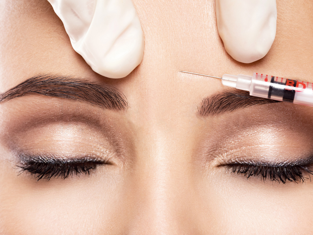 Woman getting Botox, Xeomin, Dysport, or Jeuveau treatment