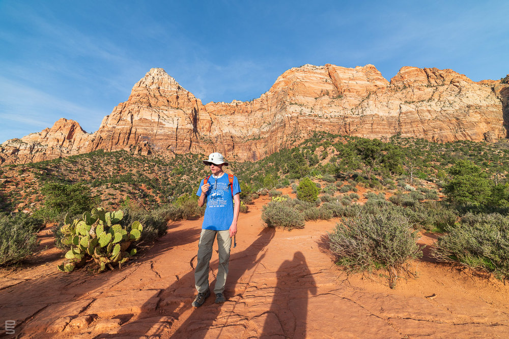 Pausing for some water during an evening hike up The Watchman, at Zion National Park. You can see my shadow as I take the picture.
