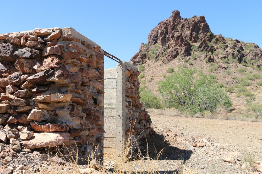 The dynamite storage building still stands east of the mountain
