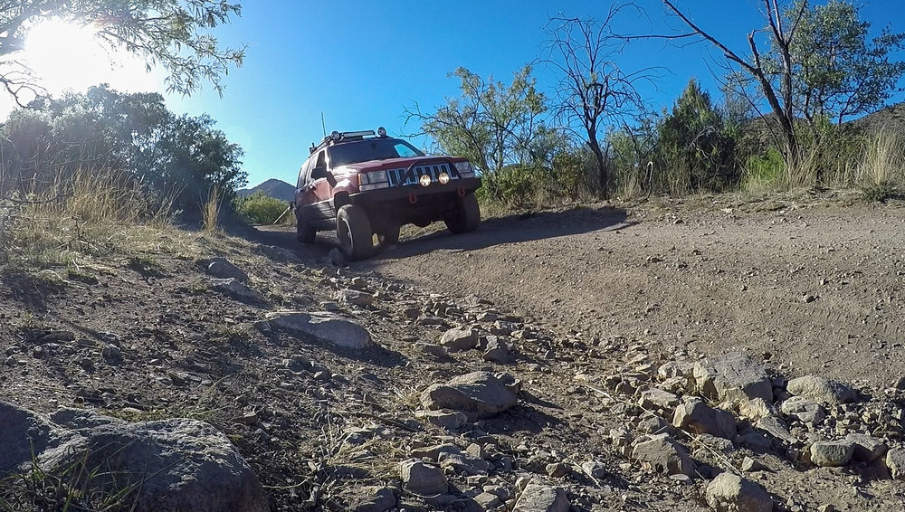 Flexing the Jeep out a bit on a side road in the Dragoon Mountains.