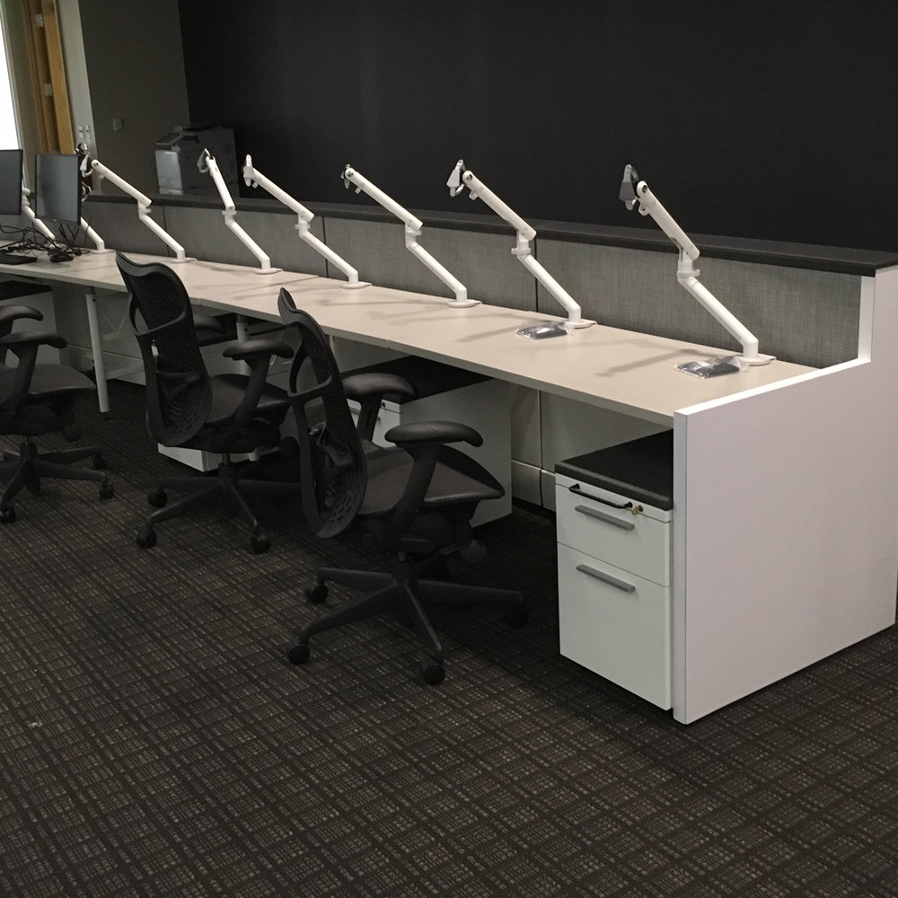 Curved IT Desk - A custom desk with integrated standard product for power and data