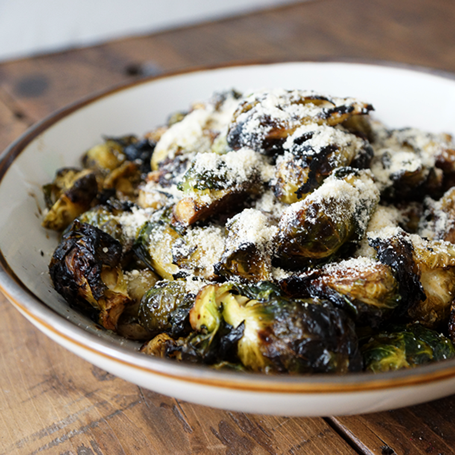 ROASTED PARMASAN BRUSSELS SPROUTS  A crowd pleaser. slightly charred, crisp, savory with hints of molasses from the balsamic vinegar, accompanied by the sharp, nutty taste of quality Parmesan Cheese.