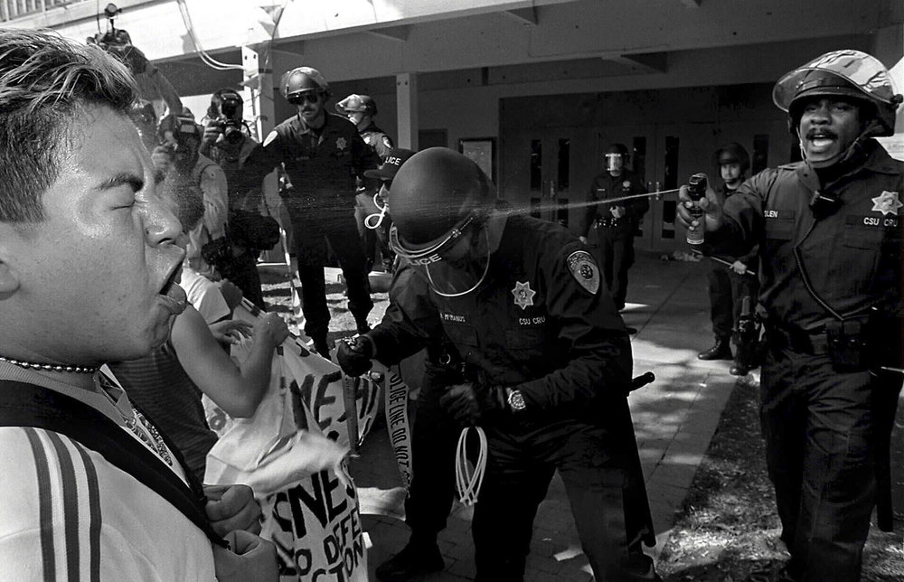 A picture I did while still studying photojournalism at San Francisco State many years ago. It was a small riot on the Cal State Northridge campus. I won first place in a pretty big national competition for the photo.