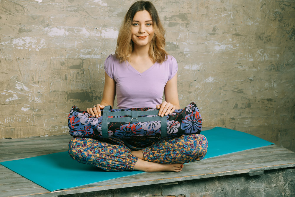 woman holding yoga bag.jpg