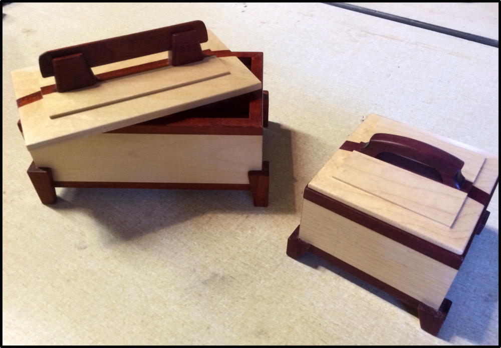 Inlaid boxes made in the woodshop.