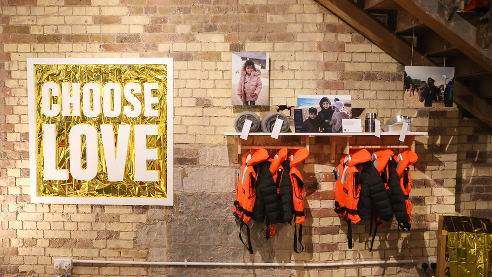 "CHOOSE LOVE   If you head over to Carnaby Street, duck onto Foubert's Place and take yourself into the Choose Love store. Make some purchases and leave with nothing. ""Sorry, what?!"" you say….bear with us. The Choose Love store is a new model of charitable giving that raised nearly £1 million in 2017. They raise funds for refugees and stocks items such as nappies, tents, sleeping bags and more, which you buy and they are then in turn given to those in need. 100% of donations from the store go straight to supporting front line services and thousands of meals amongst other things, are provided over the cold winter months. The store was created by Help Refugees in partnership with creative collective, Glimpse and has a huge celebrity backing. So take the money you were going to spend on unwanted socks for Uncle Albert and plain and simply, Choose Love instead this Christmas.  Facebook  