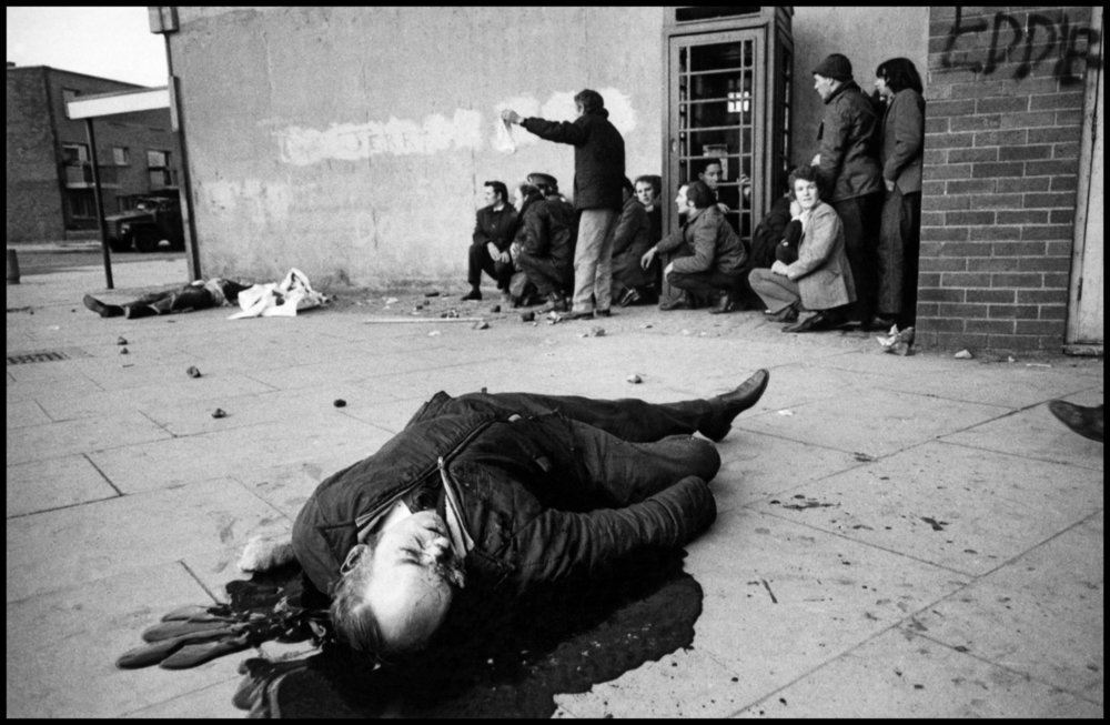 NORTHERN IRELAND. Derry / Londonderry. 30th January 1972 . A victim, Barney McGuigan, lies in a pool of blood as the shooting stops on Bloody Sunday. Contact email: New York : photography@magnumphotos.com Paris : magnum@magnumphotos.fr London : magnum@magnumphotos.co.uk Tokyo : tokyo@magnumphotos.co.jp Contact phones: New York : +1 212 929 6000 Paris: + 33 1 53 42 50 00 London: + 44 20 7490 1771 Tokyo: + 81 3 3219 0771 Image URL: http://www.magnumphotos.com/Archive/C.aspx?VP3=ViewBox_VPage&IID=2S5RYD1VKS2&CT=Image&IT=ZoomImage01_VForm