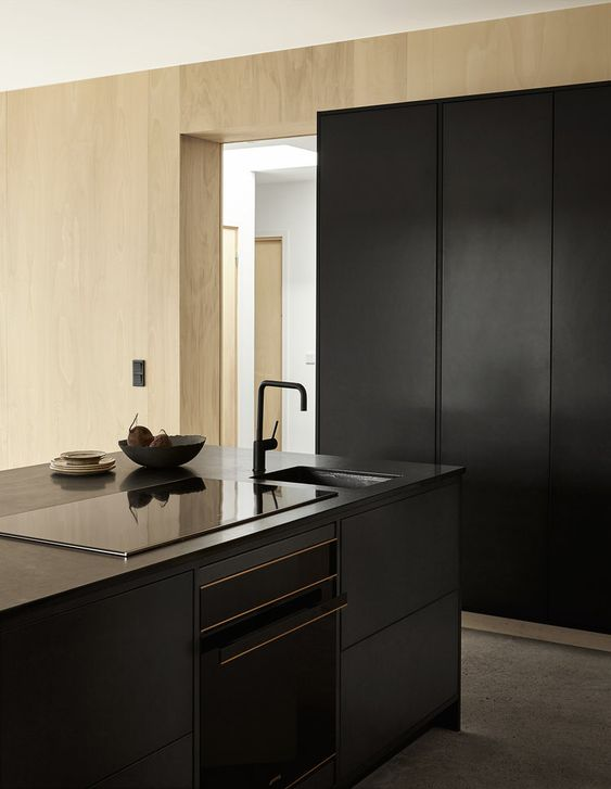 Black valchromat kitchen for artist Emma Bernhard in Torekov, Sweden. www.byrastrom.com