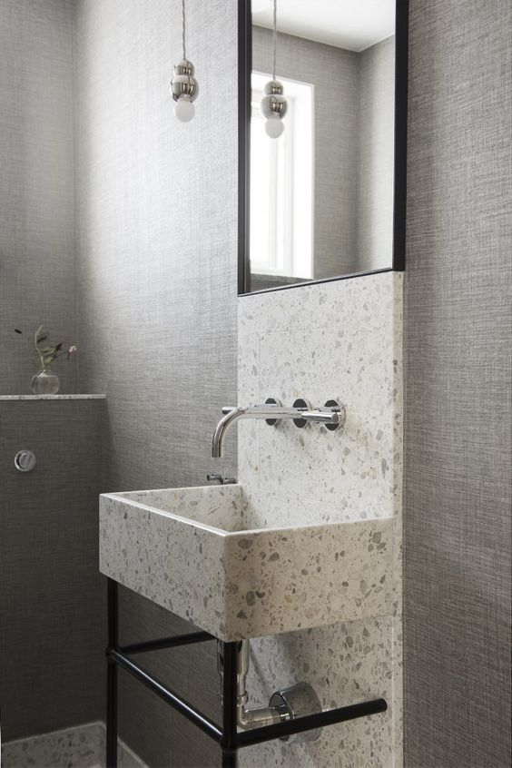 Guest Bathroom with Mirror and Basin in Terrazzo by Liljencrantz Design | Structure Wallpaper from Elitis | Lighting by Michael Anastassiades for Svenskt Tenn